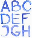 Handskrivet blått vattenfärgalfabet royaltyfri fotografi