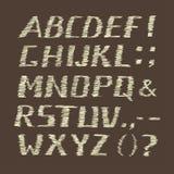 Handskrivet kritaalfabet på brun bakgrund Arkivbild