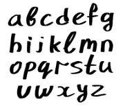 handskrivet litet för alfabet Fotografering för Bildbyråer
