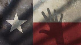 Handskugga på Texas Flag Fotografering för Bildbyråer