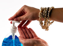 Handsoap squeezed into hand - close up Stock Image