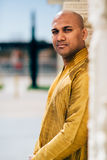 Handsom Indian Man in Gold Kurta at the Temple. The handsome Indian man wears a gold kurta and posed at a temple Stock Photography