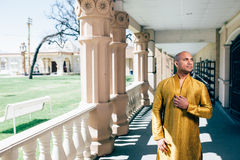 Handsom Indian Man in Gold Kurta at the Temple Stock Images