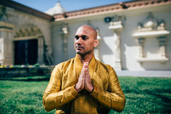 Handsom Indian Man Greeting Namaste in Gold Kurta at the Temple. Handsom Indian Man Greeting Namaste, in Gold Kurta at the Temple Stock Image