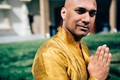 Handsom Indian Man Greeting Namaste in Gold Kurta at the Temple. Handsom Indian Man Greeting Namaste, in Gold Kurta at the Temple Stock Photo