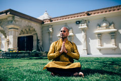 Handsom Indian Man Greeting Namaste in Gold Kurta at the Temple Royalty Free Stock Photos
