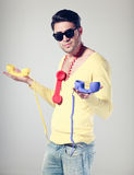 Handsom men and funny guy with colorful phones Royalty Free Stock Images