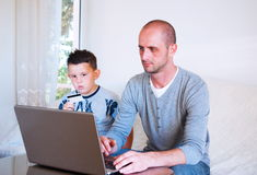 Handsom young businessman working at home Stock Photo