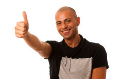 Handsom young man gesturing success with thumb up isolated over. White background Royalty Free Stock Photo