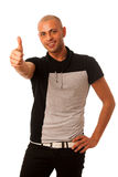 Handsom young man gesturing success with thumb up isolated over Stock Photography