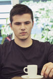 Handsom young man relaxing. Handsome young man portrait sitting outdoor Stock Images