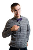 Handsom young man in shirt with bow wearing glasse. S look at camera isolated on white Royalty Free Stock Images