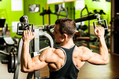 Handsom young man workout in fitness gym. For healthy and muscular body Royalty Free Stock Photography