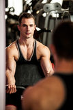 Handsom young man workout in fitness gym Stock Photos