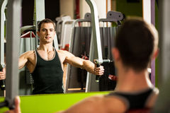 Handsom young man workout in fitness gym. For muscular body Royalty Free Stock Photography