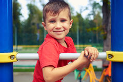 Handsome adorable boy having fun on outdoor playground Royalty Free Stock Photography