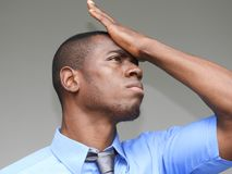 Forgetful Black Person. A handsome adult african male Royalty Free Stock Image