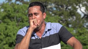 Adult Hispanic Man Coughing. A handsome adult hispanic man stock video footage