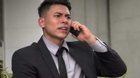Angry handsome adult hispanic man using phone. A handsome adult hispanic man stock video