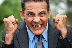 Anxious Adult Business Man. A handsome adult hispanic man stock photo