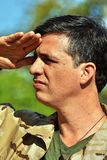 Army Male Soldier Saluting. A handsome adult hispanic man Royalty Free Stock Image