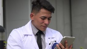 Confused hispanic male doctor stock video
