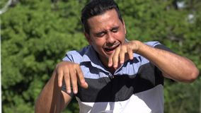 Crying Adult Hispanic Man. A handsome adult hispanic man stock video