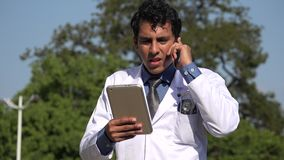 Hispanic doctor diagnosis talking on phone. A handsome adult hispanic man stock video