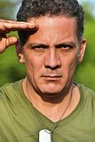 Good Looking Male Soldier Saluting. A handsome adult hispanic man Royalty Free Stock Photo