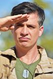 Good Looking Male Soldier Saluting. A handsome adult hispanic man Royalty Free Stock Photos