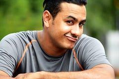 Goofy Male Athlete. A handsome adult hispanic man Stock Image