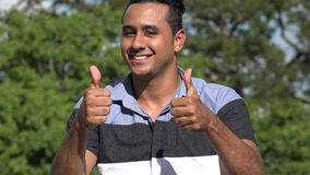 Happy Adult Hispanic Man Thumbs Up. A handsome adult hispanic man stock footage