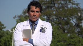 Happy hispanic doctor posing. A handsome adult hispanic man stock video footage