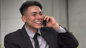 Happy handsome adult hispanic man using phone. A handsome adult hispanic man stock video footage