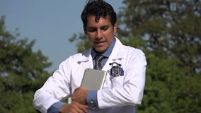 Happy hispanic doctor with tablet posing. A handsome adult hispanic man stock video