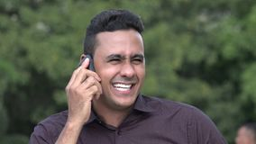 Happy Hispanic Man Using Cell Phone. A handsome adult hispanic man stock video footage