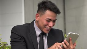 Happy successful hispanic man using cell phone. A handsome adult hispanic man stock video