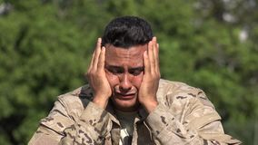 Heartbroken Unhappy Hispanic Male Soldier. A handsome adult hispanic man stock video footage