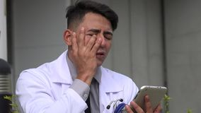 Hispanic male doctor and stress stock footage