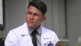 Hispanic male doctor thinking stock footage