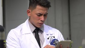 Hispanic male doctor using tablet. A handsome adult hispanic man stock footage
