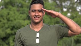 Hispanic Male Veteran Saluting. A handsome adult hispanic man stock video footage