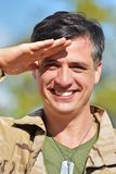 Latino Male Soldier Saluting. A handsome adult hispanic man Royalty Free Stock Images