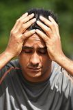 Male Athlete Under Stress. A handsome adult hispanic man Royalty Free Stock Image