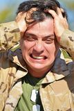 Male Soldier Under Stress. A handsome adult hispanic man Stock Photography