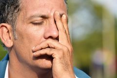 Male Under Stress. A handsome adult hispanic man Stock Image