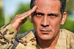 Military Male Soldier Saluting. A handsome adult hispanic man Royalty Free Stock Images