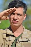 Military Male Soldier Saluting. A handsome adult hispanic man Royalty Free Stock Photo