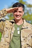 Minority Male Soldier Saluting. A handsome adult hispanic man Royalty Free Stock Photos