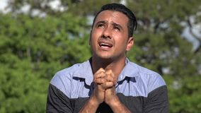Praying Adult Hispanic Man. A handsome adult hispanic man stock footage